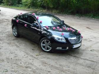 Opel insignia, stroin w różu. Tuchola